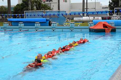 KEEP SWIMMING: The recruits practice propelling themselves through the water
