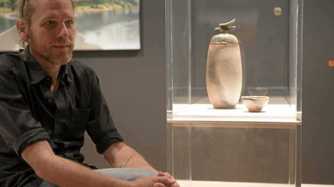 Agnes Water artist Tobias De Maine with his Bayton Award winning piece Death and Devotion: urn with bowl