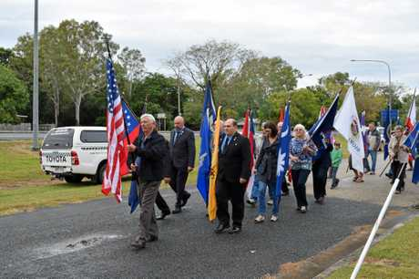 WALK TOGETHER: Marching and remembering the lives that were lost in the Bakers Creek plane crash in 1943.