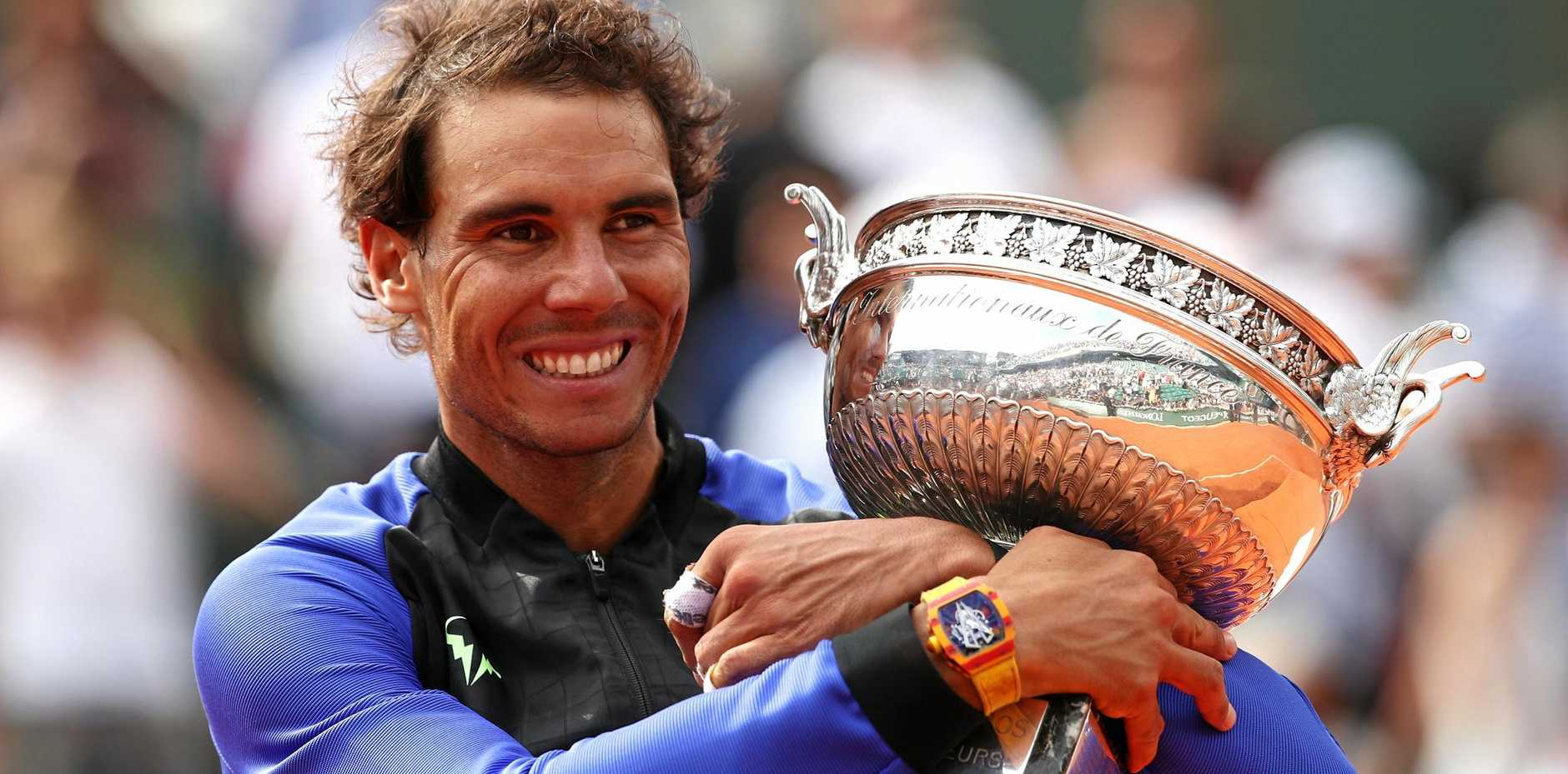Rafael Nadal celebrates victory after the men's singles final against Stan Wawrinka