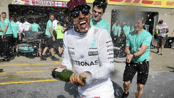 Mercedes driver Lewis Hamilton, of Britain, celebrates after winning the Formula One Canadian Grand Prix in Montreal