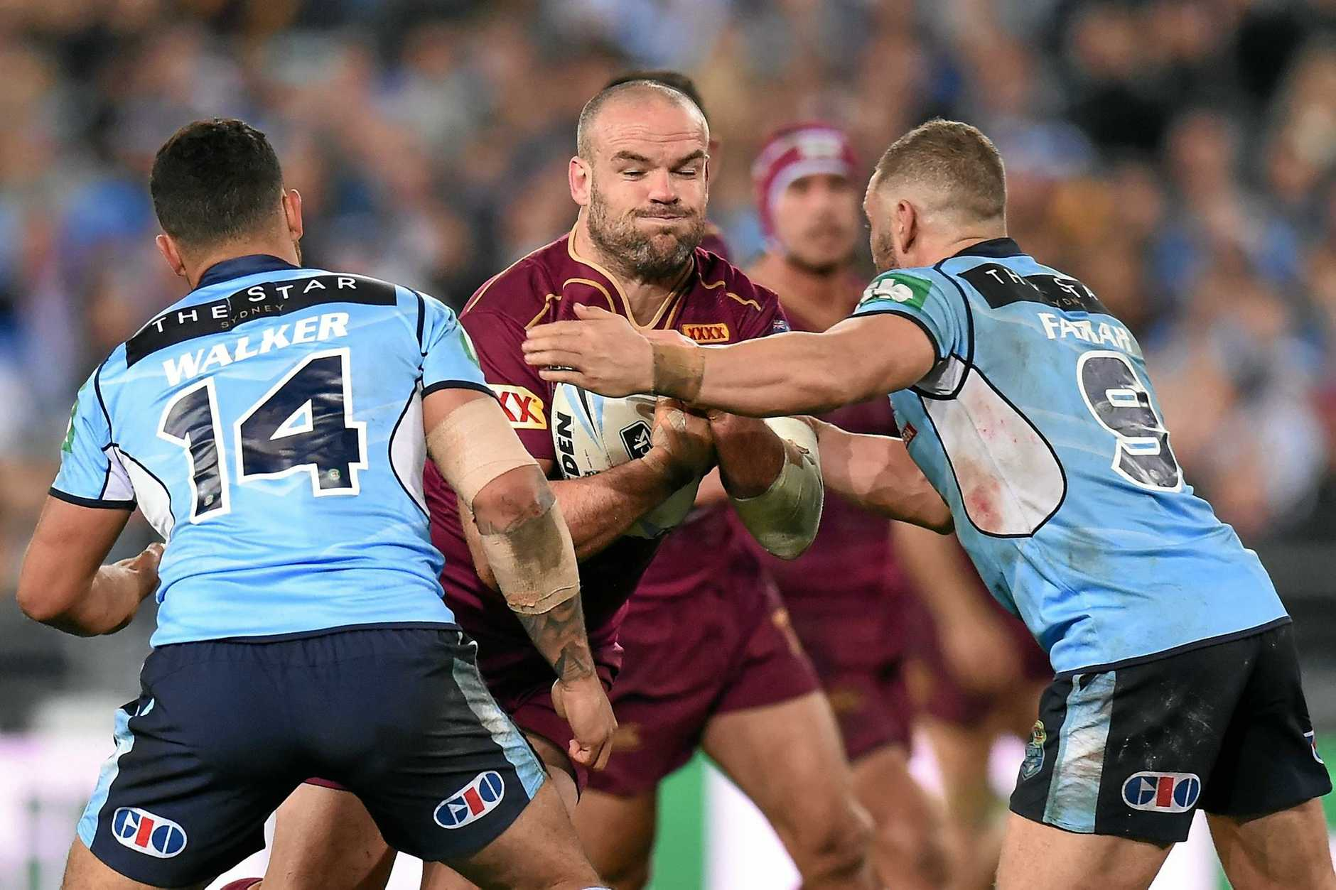 Nate Myles of the Maroons is tackled by Dylan Walker and  of the Robbie Farrah of the Blues during State of Origin Game I between the NSW Blues and Queensland Maroons, at ANZ Stadium in Sydney on Wednesday, June 1, 2016. (AAP Image/Dean Lewins) NO ARCHIVING, EDITORIAL USE ONLY
