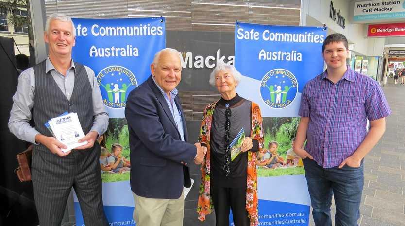 Safe Communities Australia guest speaker John Bolton (left), national president Ron Hutchins, Mackay branch president Margaret Airoldi, and guest speaker from the UK, Ryan Sykes in Victoria Street today.