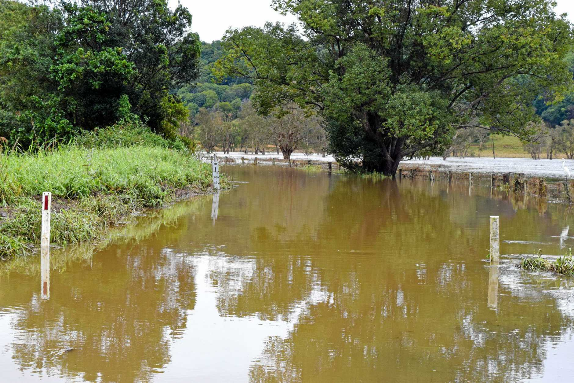 Old Bangalow Road downstream from Tintenbar Road to Tamarind Drive has been cut off by rising waters.