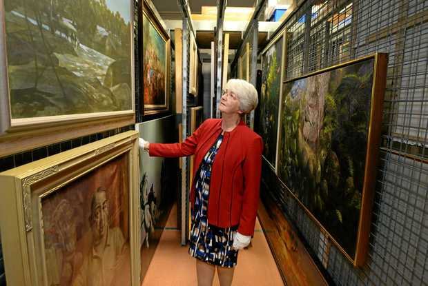Rockhkampton Mayor Margaret Strelow inspects some of the art works in storage at the art gallery because there is not enough gallery space to display them all.