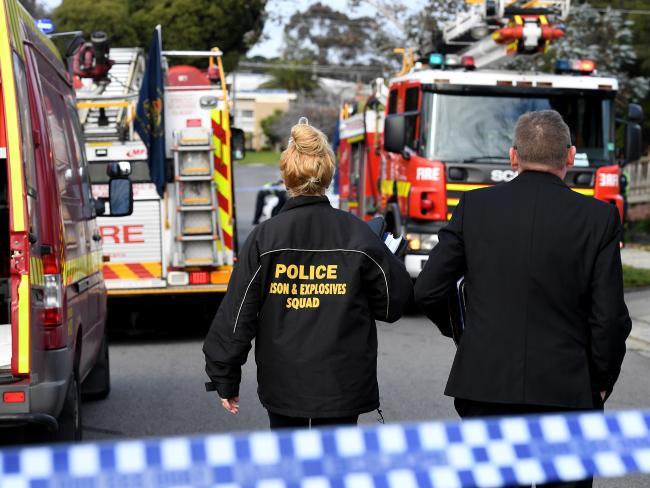 Fire investigators attend the fire.