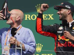 Patrick Stewart downs a 'shoey' at Canadian Grand Prix.