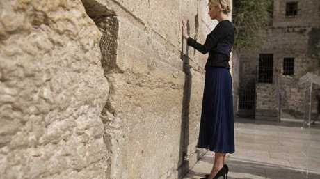 Ivanka Trump touches the Western Wall, Judaism's holiest prayer site, in Jerusalem's Old City  (Heidi Levine, pool via AP)