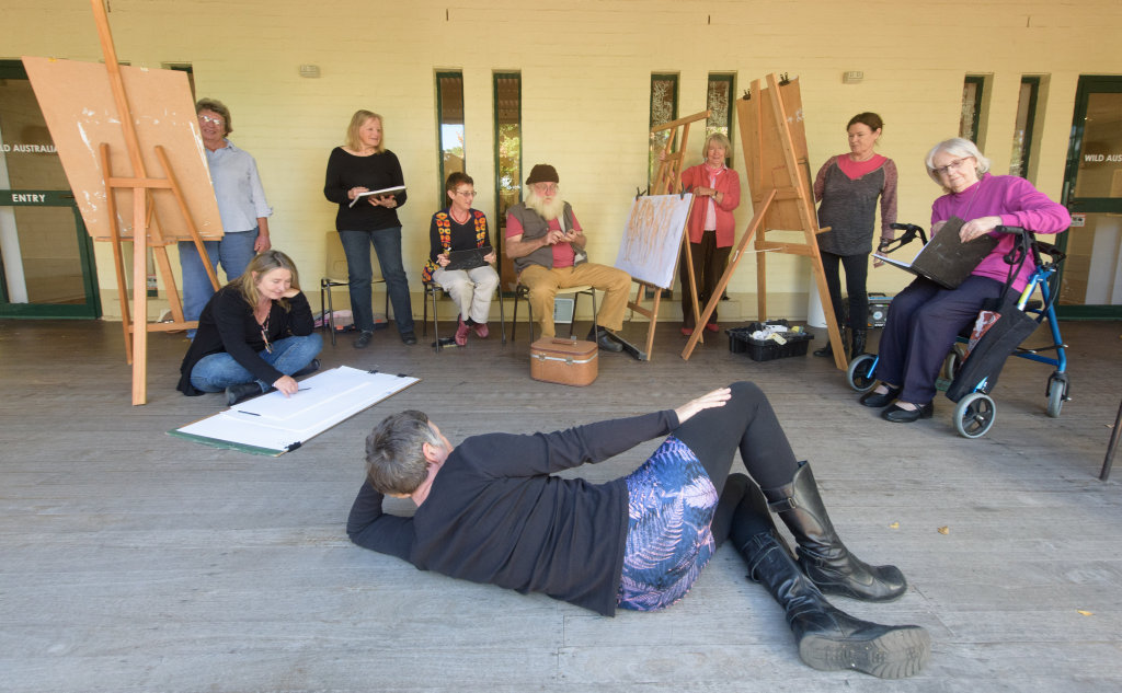It's not lying down on the job, it's art - as Sammy Lovejoy poses for the Friday life drawing class at the Grafton Regional Gallery.