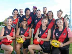 Women take to the field in history making AFL moment