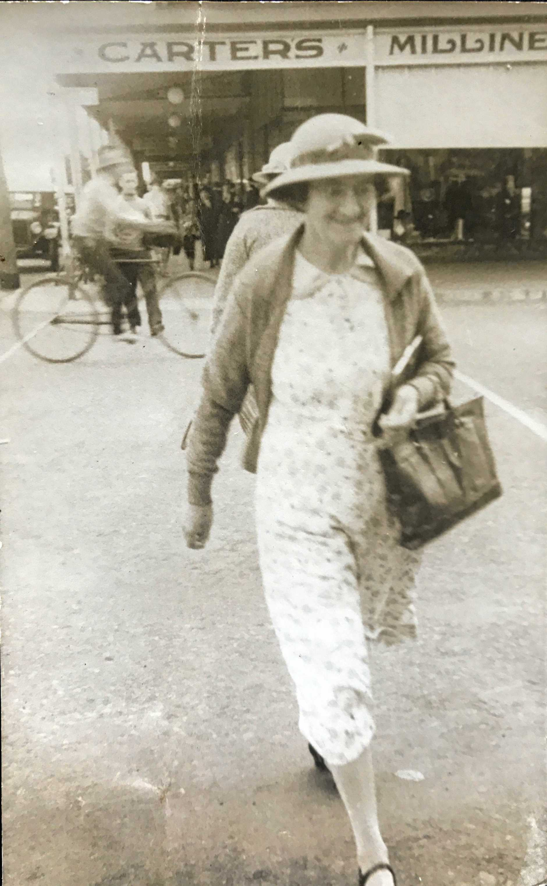 Elsie Johnson does some shopping in the Bundaberg CBD. Behind her is the Carter's store on the corner of Targo and Bourbong Sts.