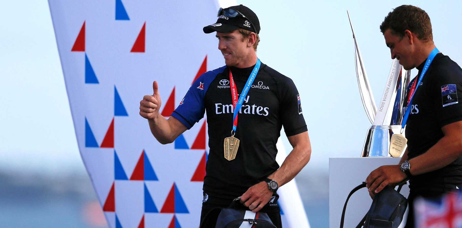 Emirates Team New Zealand skipper Peter Burling gestures to the crowd before the trophy ceremony after winning the America's Cup Challenger Playoffs in Bermuda.