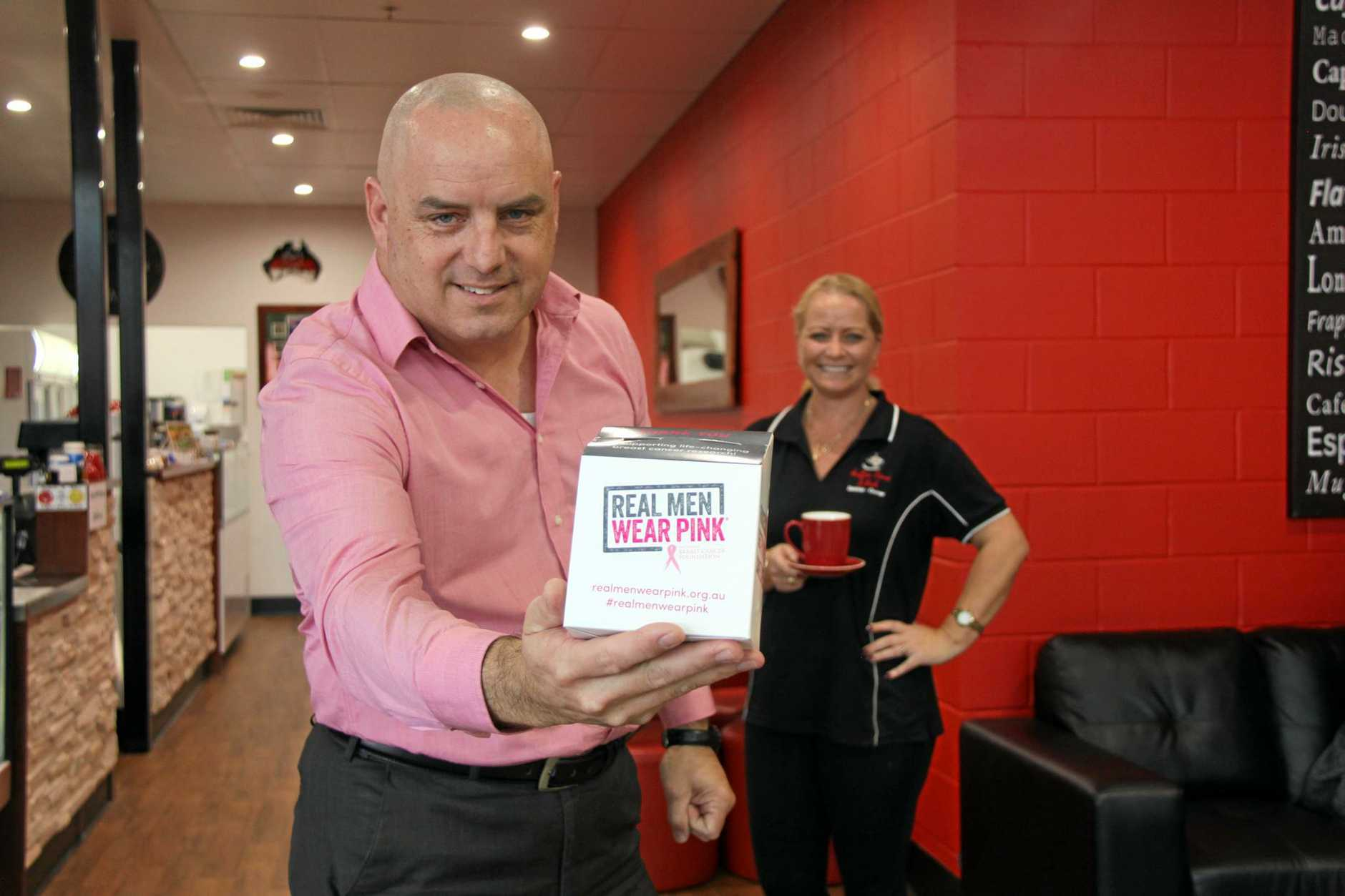 GET YOUR PINK ON: Real Men Wear Pink supporter Philip Gibson with Deb Nabbo at Coffee Time in Goonellabah. Deb will donate 20c from every coffee sold on June 16 to Philip's campaign.