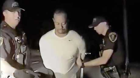 American golfer Tiger Woods being arrested on a drink-driving charge in Jupiter, Florida, in May.