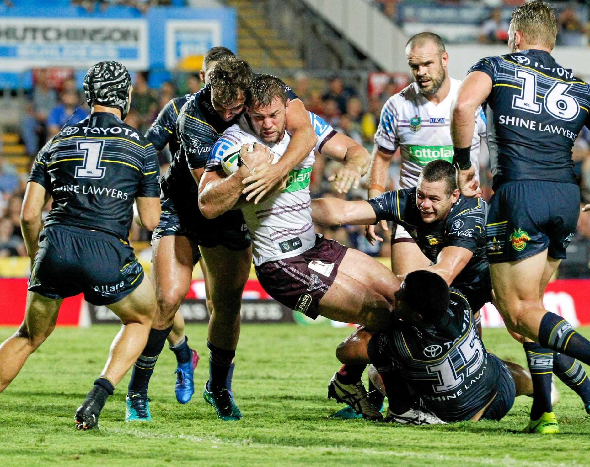 Manly forward Brenton Lawrence heads for the tryline as Cowboys defence tries to hold him back.