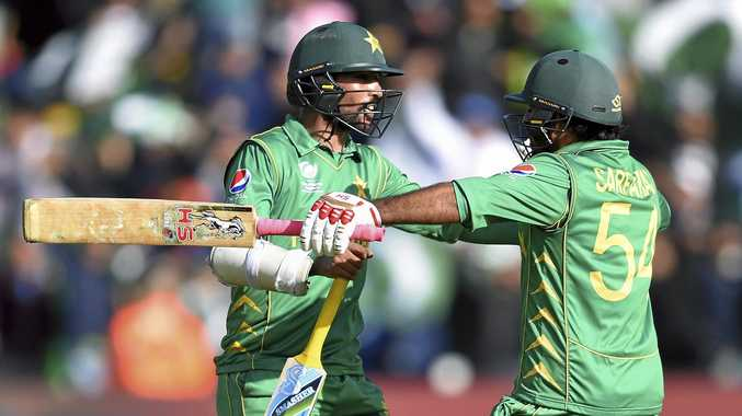 Pakistan captain Sarfraz Ahmed (right) and Mohammad Amir celebrate their win over Sri Lanka.