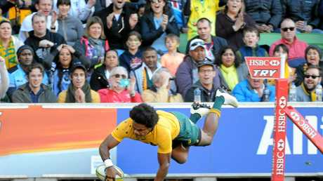 Henry Speight of the Wallabies dives to score the side's second try against Fiji.