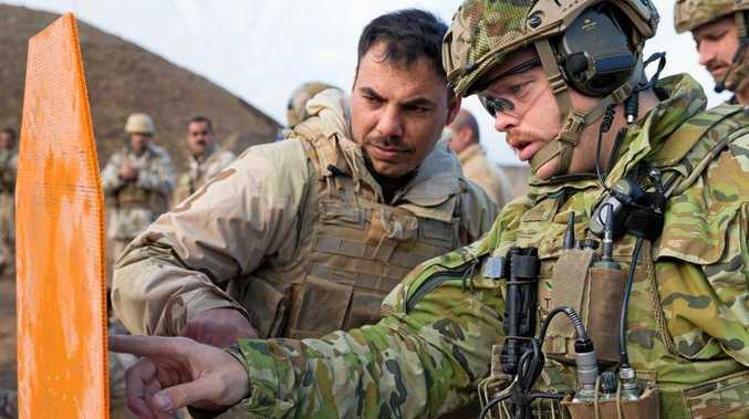 ON TARGET: Australian Army officer Captain Patrick Carmody from Task Group Taji 4 analyses an Iraqi Army soldier's shooting accuracy at Al Taqqadum, Iraq.