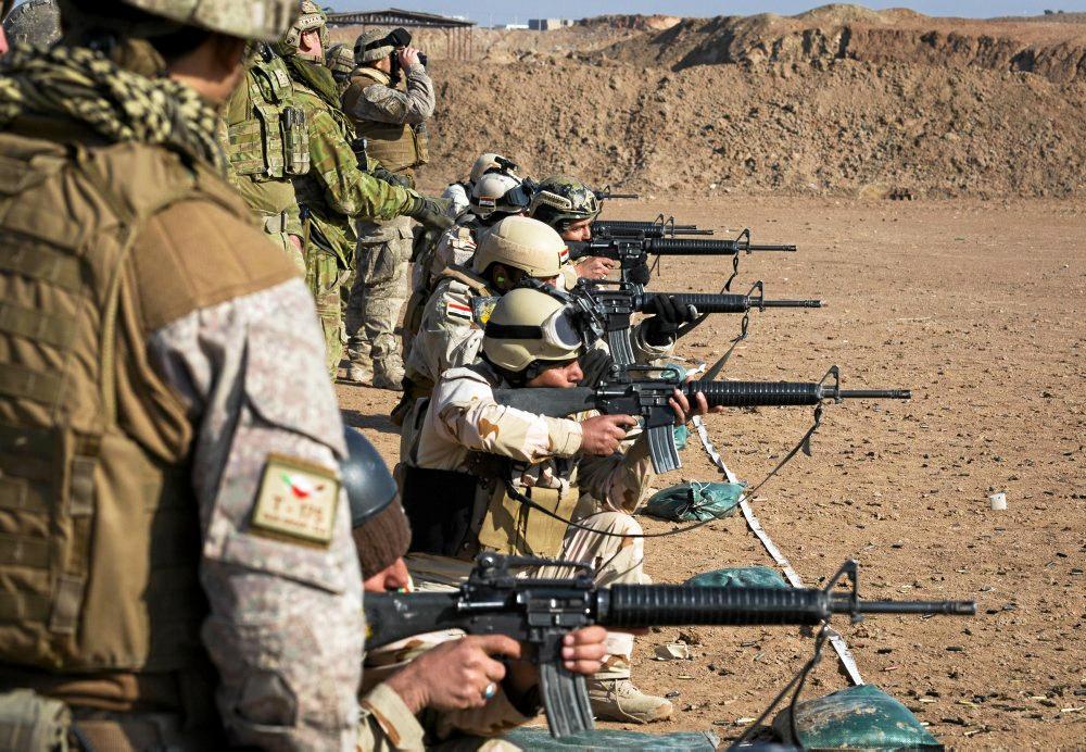 Australian and New Zealand Army trainers from Task Group Taji 4 conduct marksmanship training with an Iraqi Army training audience at Al Taqqadum, Iraq.