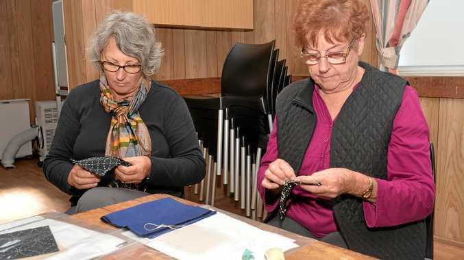 Sabine Lloyd and Barbara Plumb work on their Sashiko at the QCWA hall.