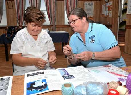 Pia Sorensen (right) teaches Tiffany Matthews how to do Needle Tatting.