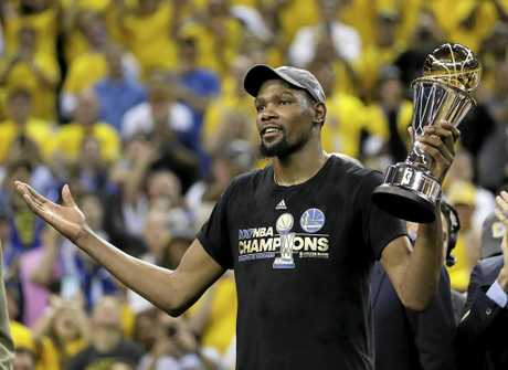 Golden State Warriors forward Kevin Durant with the Bill Russell NBA Finals MVP award.