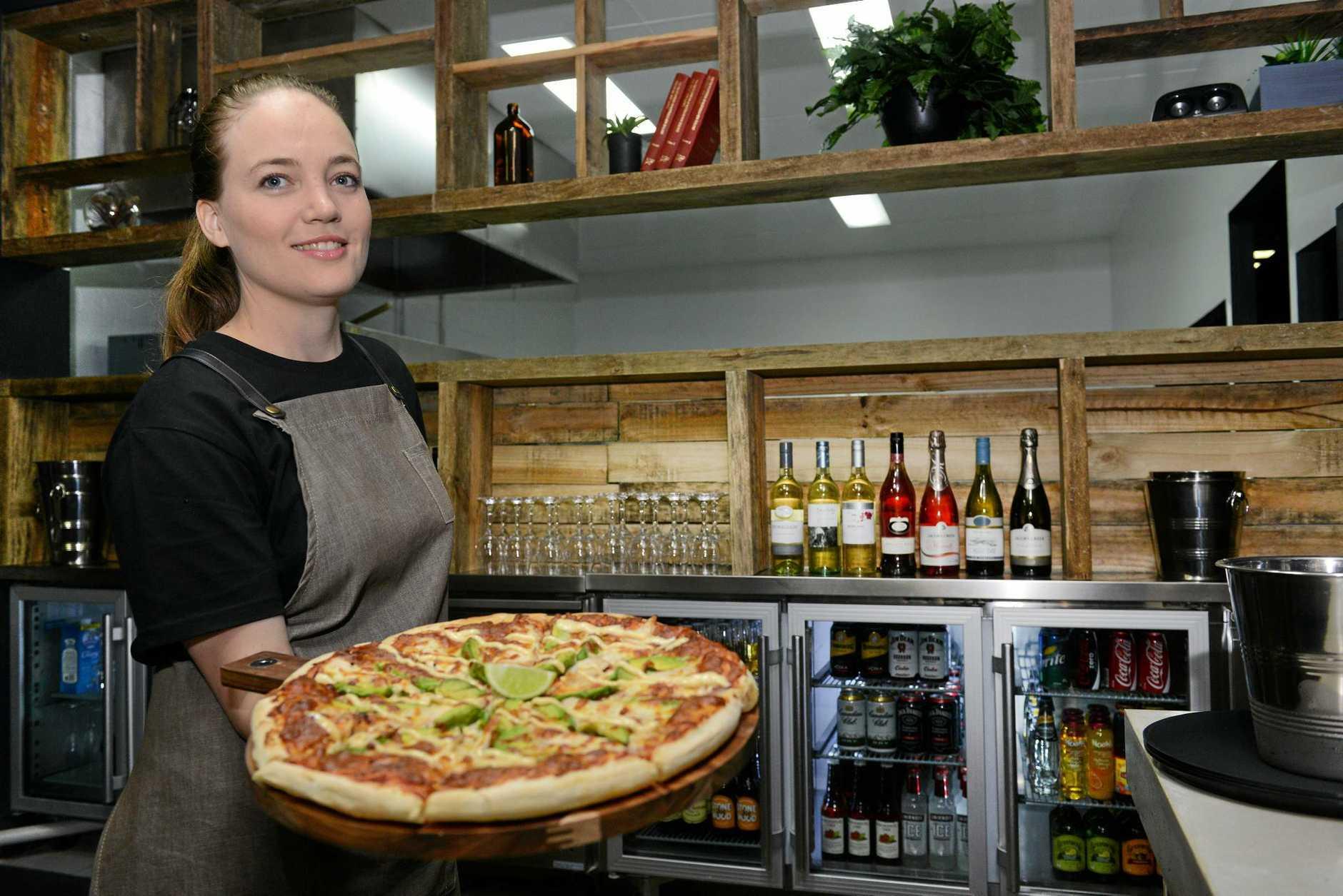 NEW BUSINESS: Melanie Szalkowski serves fresh creations at Jandas pizzeria on Bourbong, St Bundaberg. Photo: Paul Donaldson / NewsMail