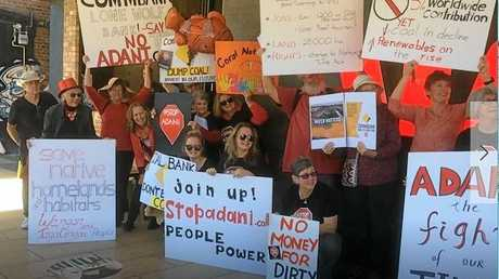 Members of the Toowoomba Stop Adani group protesting outside Westpac Bank recently.