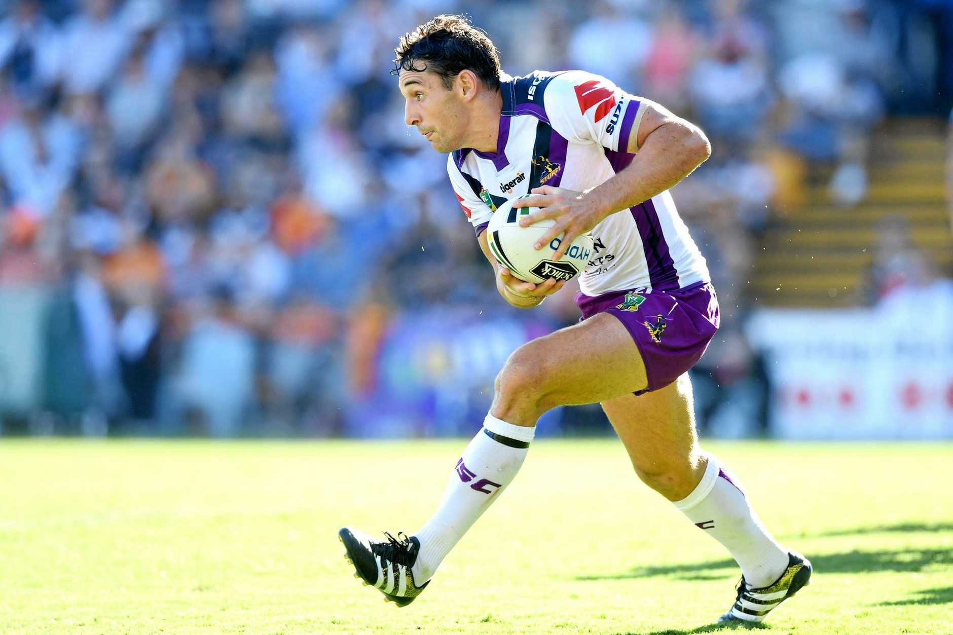 Billy Slater of the Storm runs with the ball.