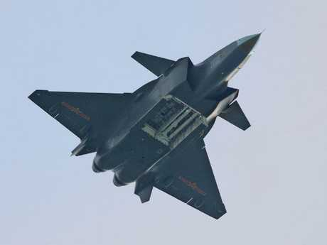 China's J-20 stealth fighter entered operational service earlier this year. Here it displays its large internal weapons bay in an overhead fly-past.