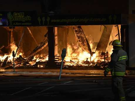 Fire Amigo's Bar and Grill in Margaret St. Firefighters are still battling to bring under control a massive fire that started in the Toowoomba CBD about 11.20pm.