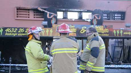 Fire crews survey the scene of the Amigo's Mexican Restaurant the morning after the fire.