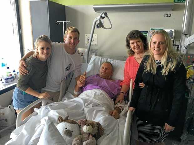 ON THE MEND: John Johnson with Annie Collins and son Mark, wife Karen and daughter Sarah Johnson.