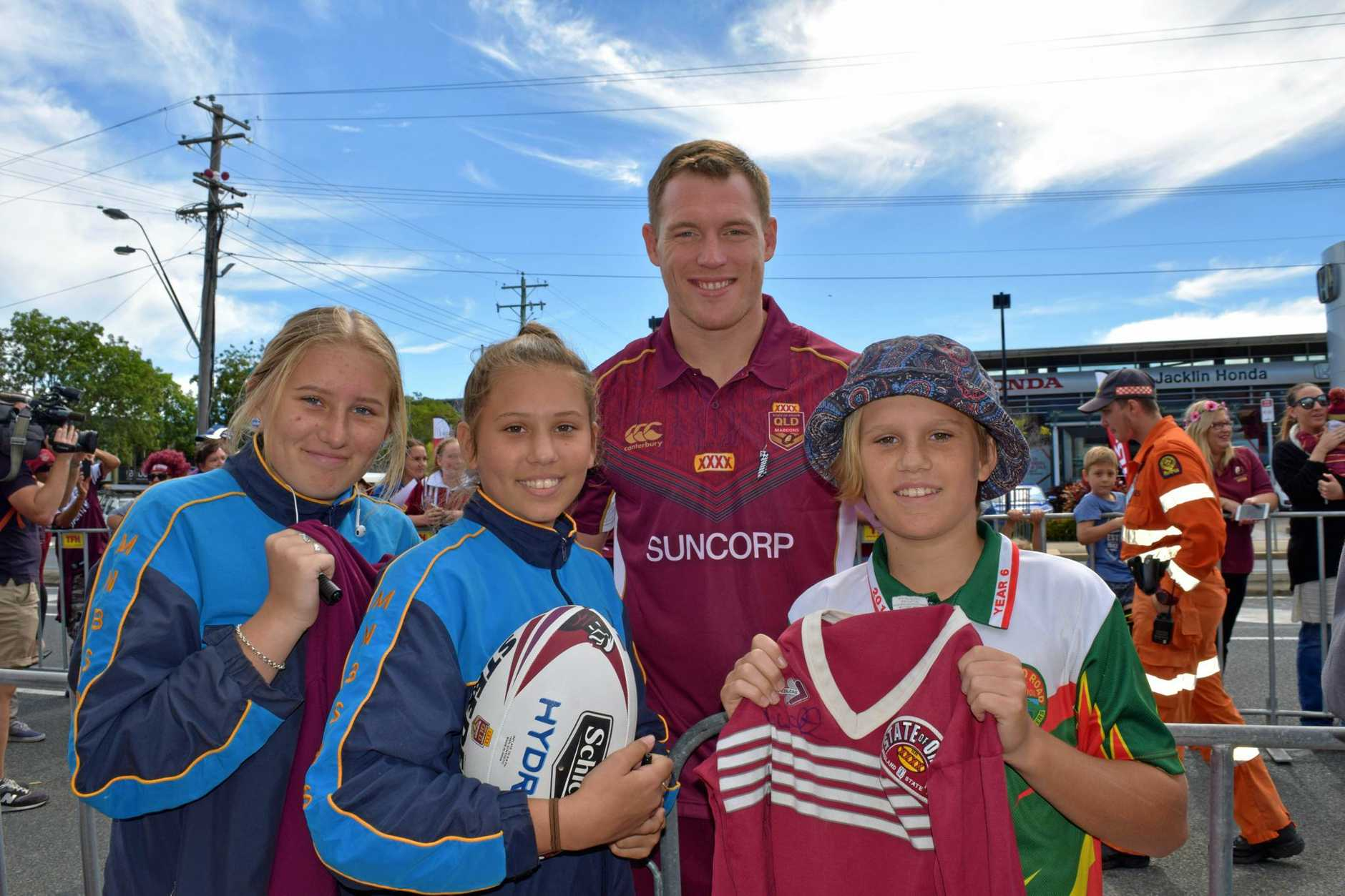 GO MAROONS: Fans pose with their favourite Origin players at this year's Mackay Maroons Fan Day on June 14.