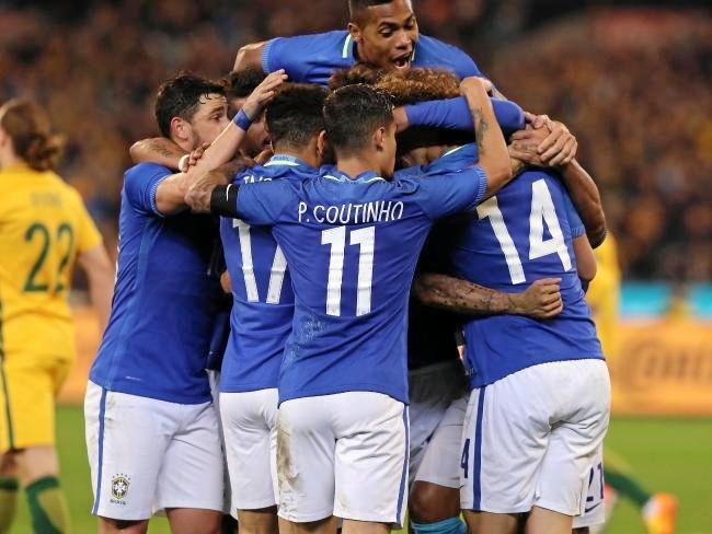 The Brazilians celebrates their second goal. Photo:News Corp Australia