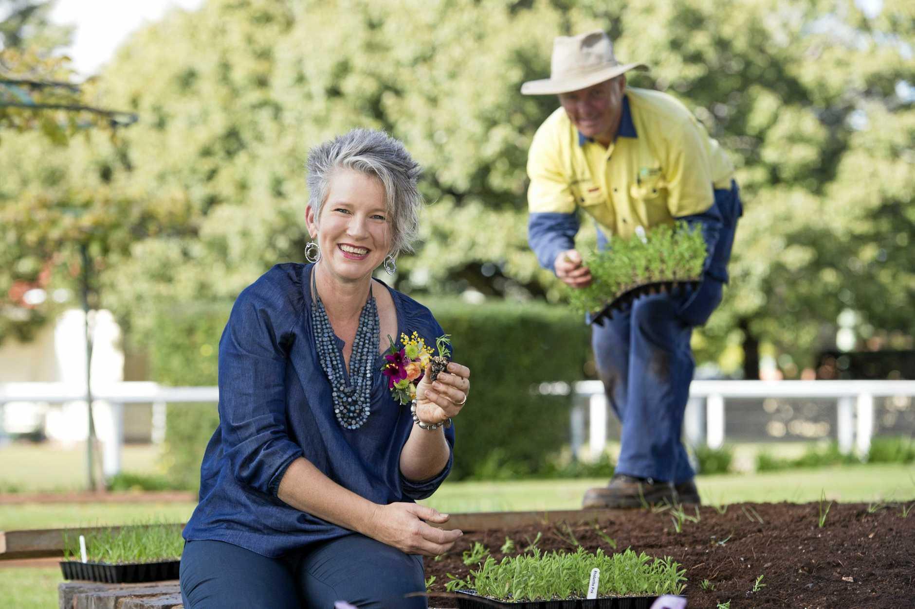READY FOR BLOOM: Gardening Australia host Sophie Thomson helps out Toowoomba Regional Council gardener Jonathon Shepherd in Laurel Bank Park.
