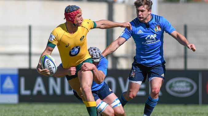 ON THE ATTACK: Toowoomba talent Hamish Stewart tries to off-load during Australia's game against Italy at the World Rugby U20s Championship.