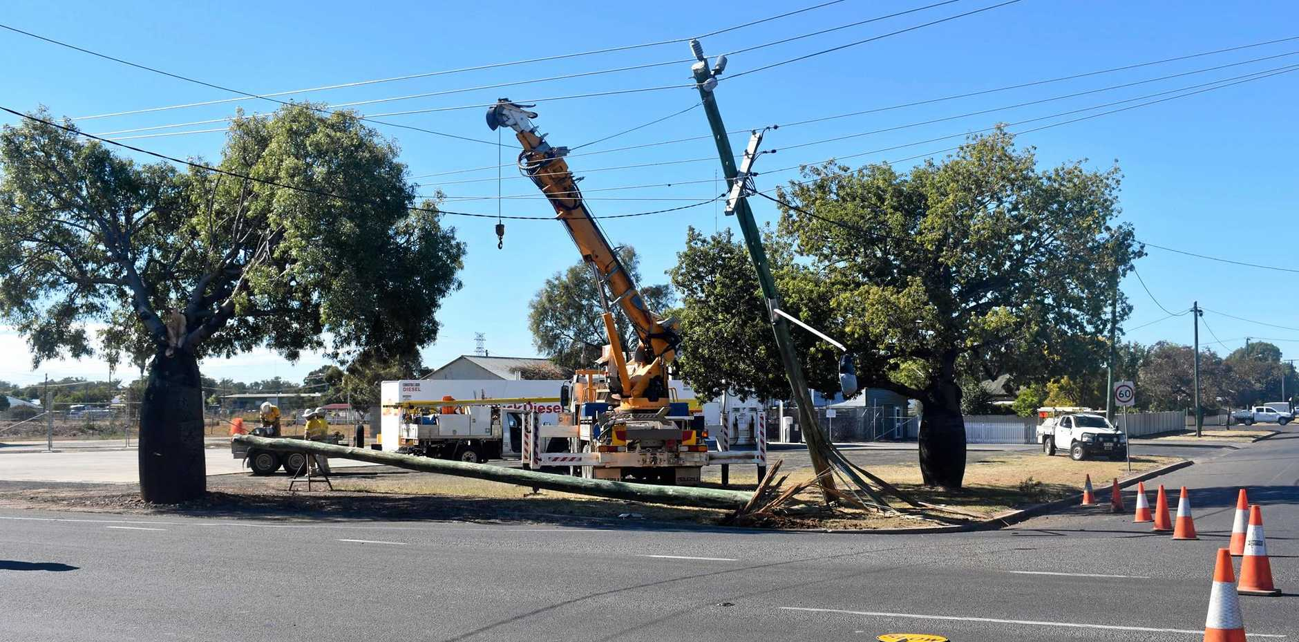 A truck carrying a wide load has collided with a power pole on the corner of Chrystal St and Warrego Hwy, causing power outages across Roma.