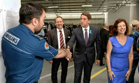 Cameron Dick meets with local paramedics at the Ipswich Ambulance Station flanked by local MP's Jim Madden and Jennifer Howard on Wednesday.