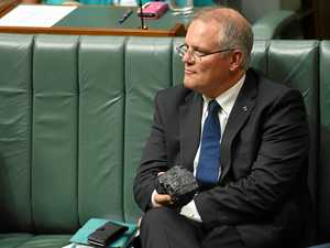 Australia's Treasurer Scott Morrison pictured holding a piece of coal during House of Representatives Question Time at Parliament House in Canberra, in February.