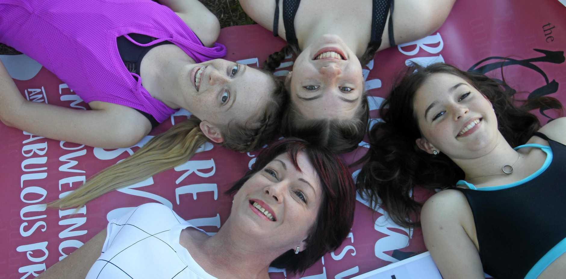 JUST FOR GIRLS: Artist and arts educator Jodie Kearns will conduct a Power of Words Project at the Just For Girls event on July 23. Joining her are (clockwise) Sophie van Moolenbrek, 13, Lily Daniel, 14, and Emma Brook, 13 from Mackay Fame Talent School.