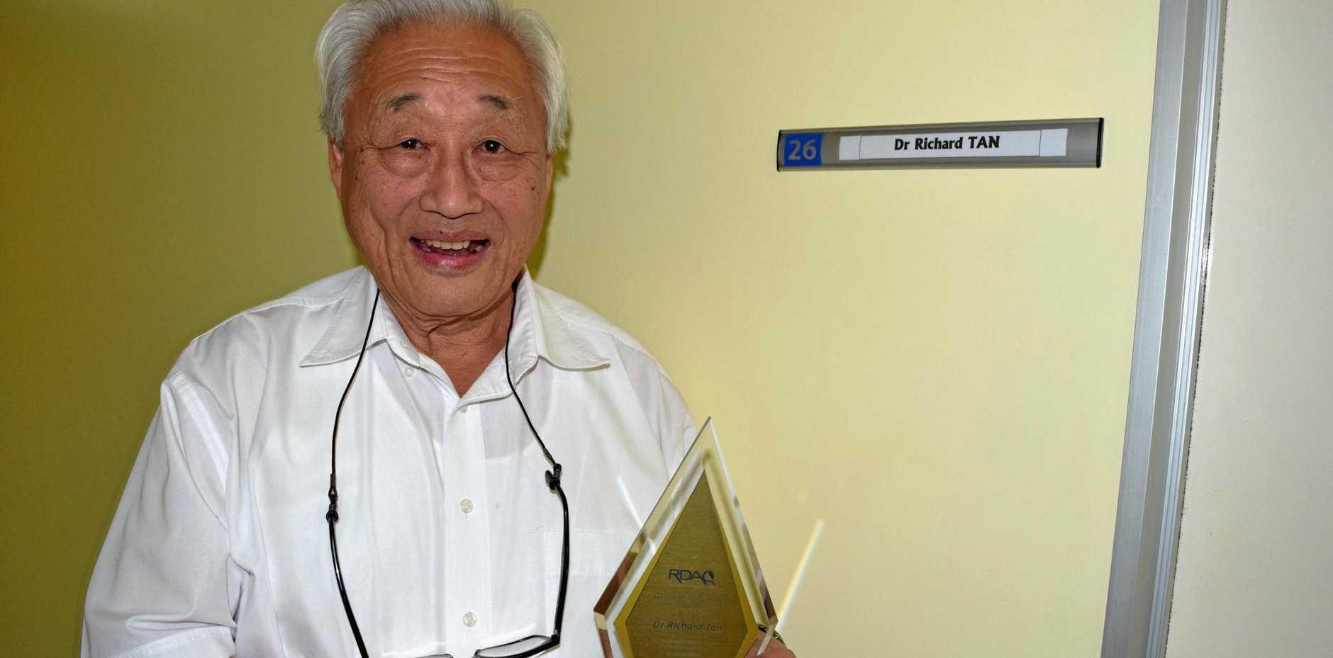 Dr Tan with his new award at his Biloela surgery.