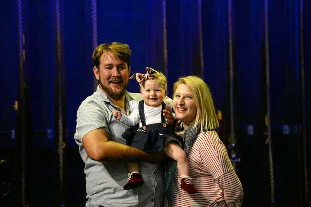Amanda and Travis Hock with baby Lucy on stage at the Pilbeam Theatre.