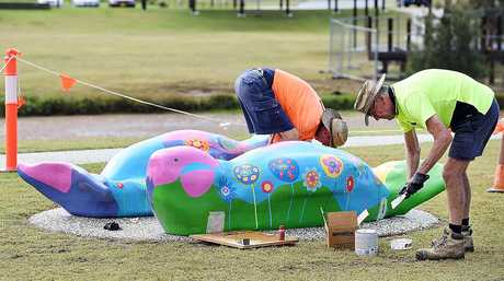 (L) Geoff Bellert and Daniel Coyne from Advantage Profiling Service with fibreglass sea animals being installed in front of the Fraser Coast Cultural Centre in Pialba.