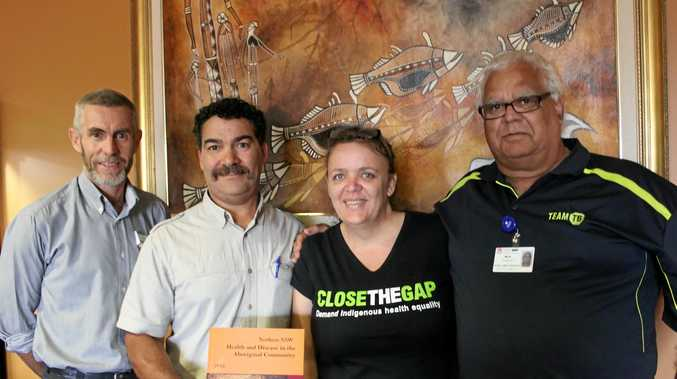 HEART WORKSHOPS: Chief author of Health and Disease in the Aboriginal Community, Associate Professor Michael Douglas, with Northern NSW Local Health District chronic care officer, Anthony Franks, senior Aboriginal health education officer, Teena Binge, and Bundjalung community representative, Mick Roberts, at the Caring and Sharing Ideas about Aboriginal Health in Lismore in 2013.
