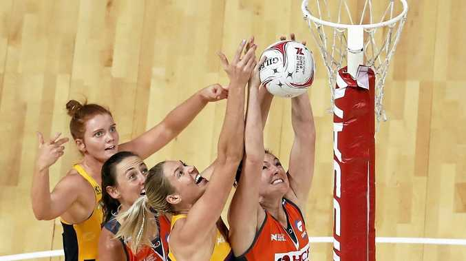 COLLISION COURSE: Stephanie Wood (L) and Caitlin Bassett (3rd L) of the Lightning fight for a high ball against Bec Bulley (2nd L) and Sam Poolman (R) during the Round 14 Super Netball match between the Giants and the Sunshine Coast Lightning at the Qudos Bank Arena, Sydney Olympic Park last month.