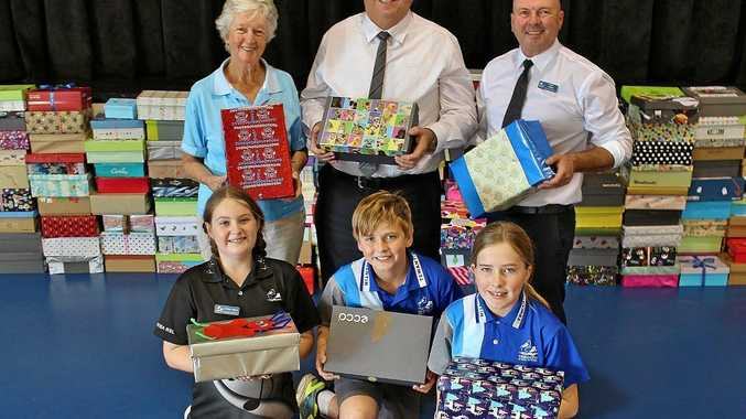 Off to Timor: (back, from left) Rotary Noosa club president Tess Alexandroff, Tewantin Community Bendigo Bank manager Wayne Hoens and Tewantin Primary School principal Rick Cass, with students (front, from left) Indianna Mason, Lochie Williams and Freya Porter.