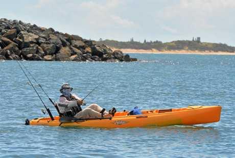 Paul Macleod fishing from his kayak near the Mackay Marina.