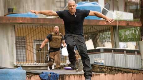 Vin Diesel (foreground) escapes from Dwayne Johnson in Fast and Furious 5. Photo: Supplied