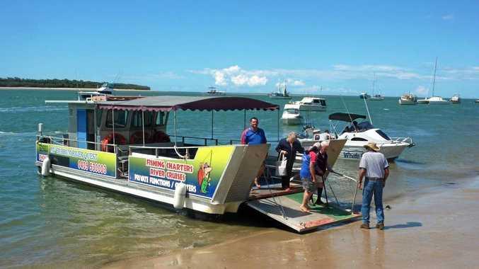 The Burrum River Quest disembarking passengers at Burrum Heads.